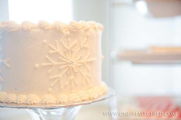 Snowflake Cross Christening CakeWinter Christening Ideas - One Small Child