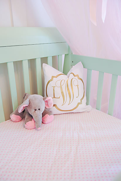 This gold monogrammed crib pillow is to die for! | See the entire nursery at One Small Child: www.onesmallchild.com