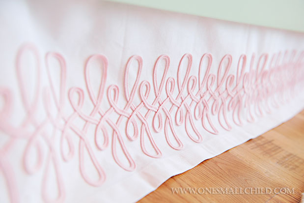 Love this pink embroidered crib skirt | See the entire nursery at One Small Child: www.onesmallchild.com