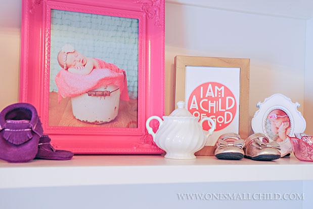 Fun shelf display for decorating a baby girl's room | See the entire nursery at One Small Child: www.onesmallchild.com