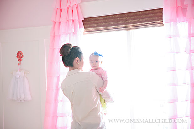 Pink ruffle curtains - perfection! | See the entire nursery at One Small Child: www.onesmallchild.com