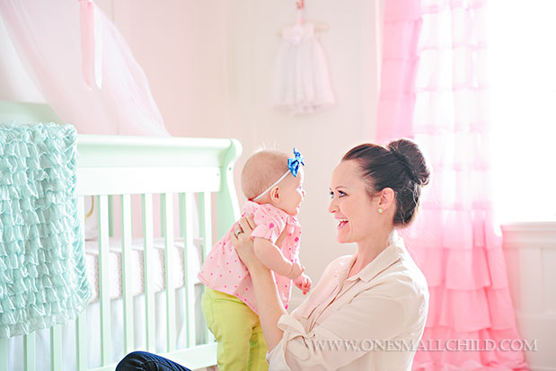 Cute baby Lyla with her mommy in her beautiful pink and aqua baby room | See the entire nursery at One Small Child: www.onesmallchild.com